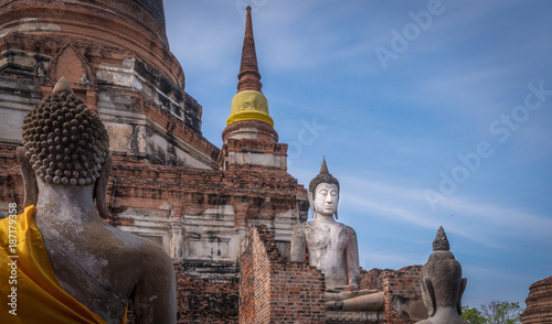 Fotoposter Temple Buddha statues in saffron sashes at the Wat Yai Chaimongkhon temple in Ayutthia Thailand
