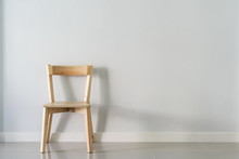 Wooden Chair Against White Wal...