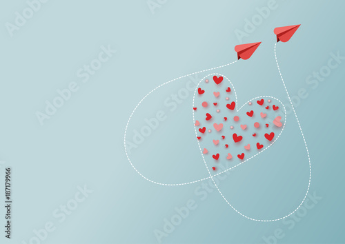 Fototapeta Paper art style of valentine's day greeting card and love concept.Couple of red airplanes flying look like heart shape.Vector illustration. obraz