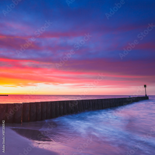 Fotobehang Aubergine Sunset on the beach, long time exposure