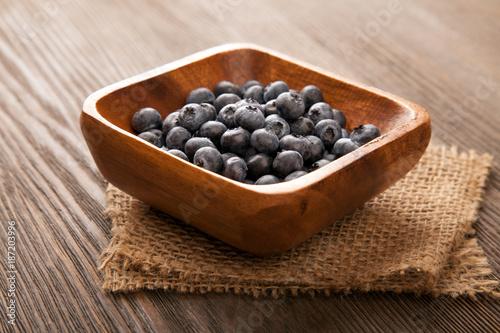 ripe sweet blueberries on wooden table © Chepko Danil