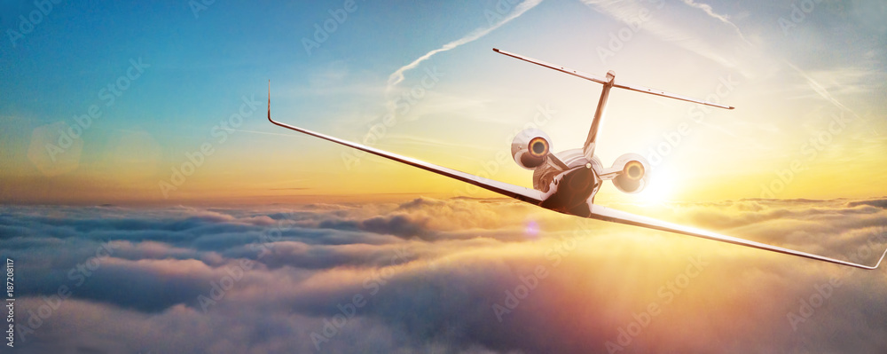 Fototapety, obrazy: Private airplane jetliner flying above clouds in beautiful sunset light.