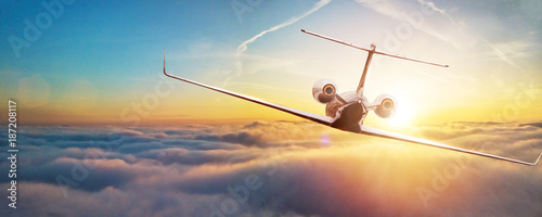 Poster Avion à Moteur Private airplane jetliner flying above clouds in beautiful sunset light.