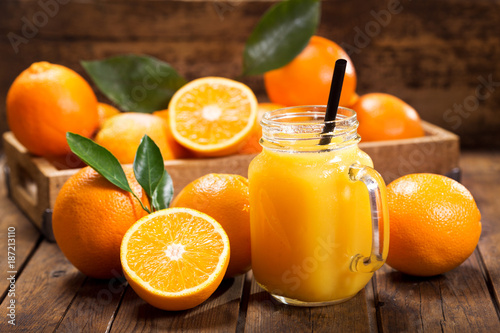 Photo Stands Juice glass jar of fresh orange juice with fresh fruits