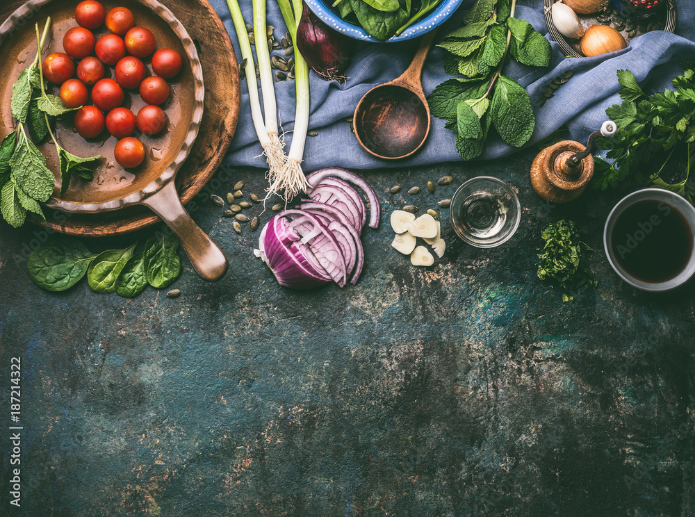 Fototapety, obrazy: Vegetarian cooking ingredients with fresh seasoning on rustic kitchen table with spoon , top view, place for text.  Clean, vegan food and healthy eating.