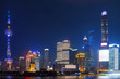 Modern city skyscrapers of Shanghai skyline at night with reflection of beautiful ligth in Huangpu river view from the bund, Shanghai, China
