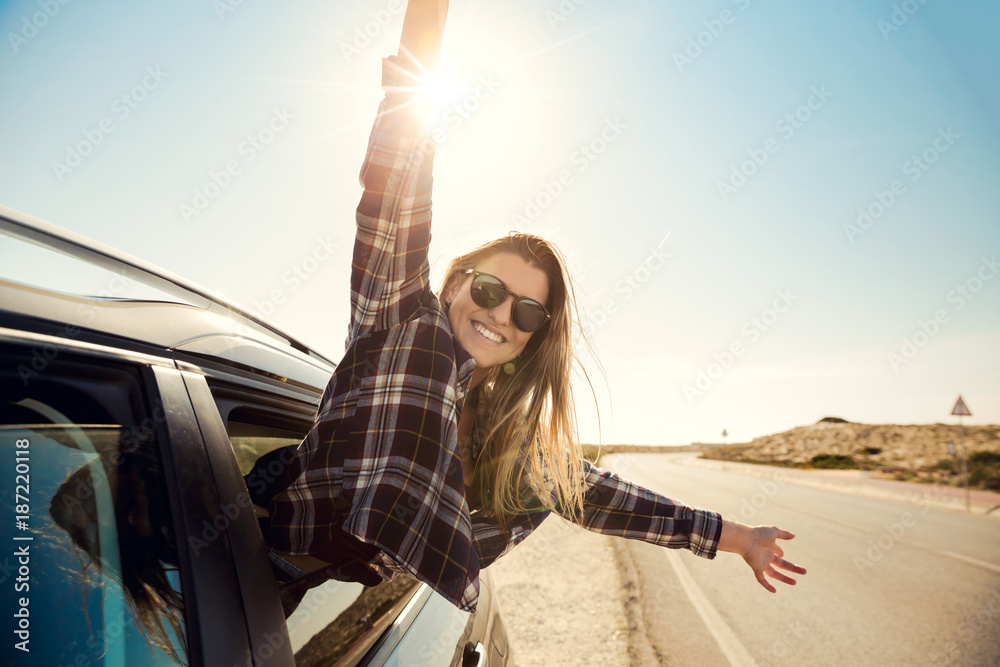 Fototapety, obrazy: happy girl looking out the car window