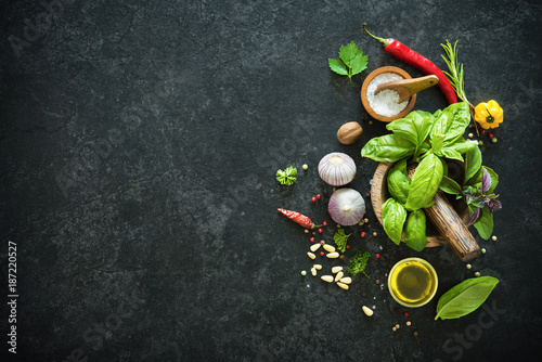 Poster Condiments Herbs and spices on black stone table