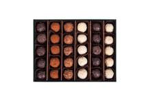 Chocolate Balls In Box On White