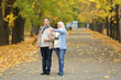 Happy mature couple taking walk in park