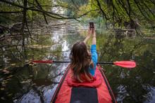 Girl Taking Selfie On Kayak