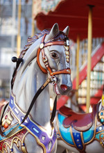 Close Up Of A White Carousel Horse Head With A Colorful Bridle, On Blurred Background. Horizontal Image.