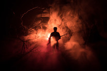 Man With Riffle At Spooky Forest At Night With Light, Or War Concept. Military Silhouettes Fighting Scene On War Fog Sky Background, World War Soldier Silhouette Below Cloudy Skyline At Night.