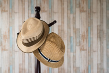 Straw Hat Hanging On Wooden Ha...