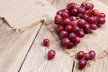 Red Grapes On Old Wooden Table...