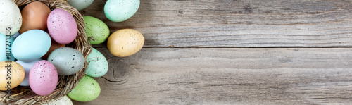 Stampa su Tela Easter eggs on rustic wooden background