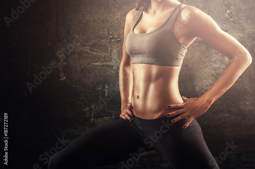 Fotografie, Obraz  Shaped woman muscular fit body stretching position