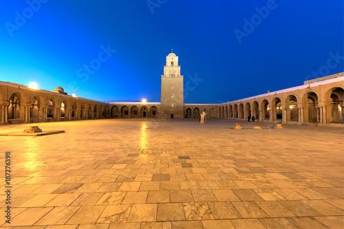 Photo  The Grand Masjid in Qayrawan - Main Minaret Overlooking the Courtyard at Sunset