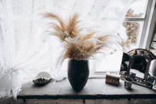 Vase In The Boho Style, Vintage Mirror, Casket And Seashell On The Windowsill. Side View