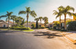 canvas print picture - Typical gated community houses with palms, South Florida. Light effect applied
