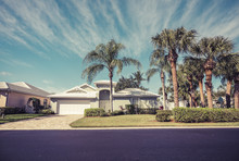 Typical Gated Community Houses With Palms, South Florida. Vintage Colors. Low Angle View