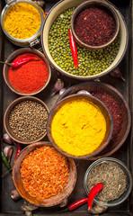 Fototapeta Przyprawy Ground spices in bowls on a wooden tray.