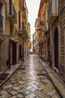 Old medieval street and pavement wet from rain in the Italian city of Bari