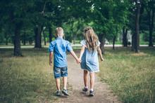 A Little Boy And Girl Walking ...