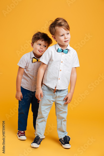 Two funny little children brothers фототапет