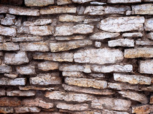 A Wall Made Of Old Flat Stones. Not An Even Masonry.