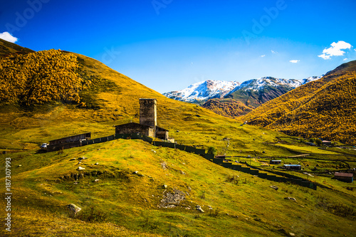 View of the village of Ushguli in a beautiful autumn landscape with white clouds in Svaneti. Georgia. Toned