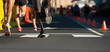 Marathon runners running on city road,detail on legs.Copy space