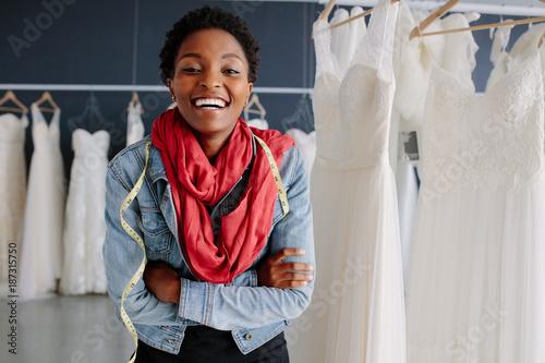 Obraz na plátne  Portrait of smiling bridal store owner