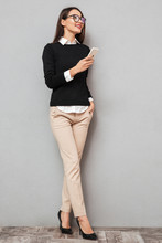 Full Length Image Of Happy Asian Woman In Business Clothes