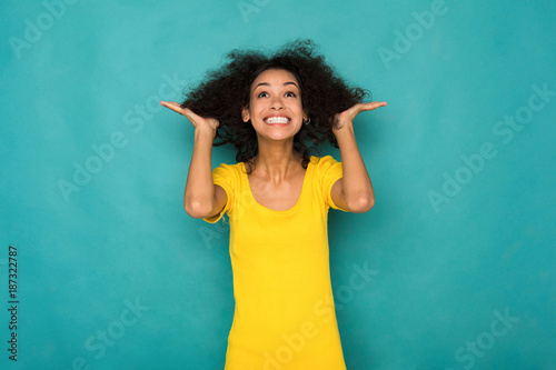 Young smiling african-american woman with arms out