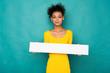 Leinwandbild Motiv Young african-american woman holding blank banner