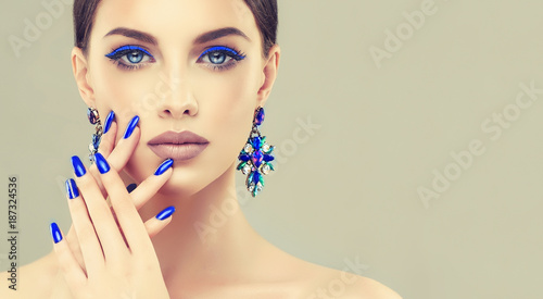 Leinwand Poster Beautiful model girl with blue  manicure on nails