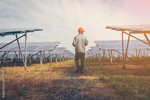 solar power plant to innovation of green energy; engineer or electrician working Slika na platnu