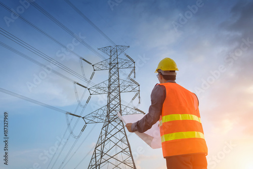 Photo Engineering working on high-voltage tower