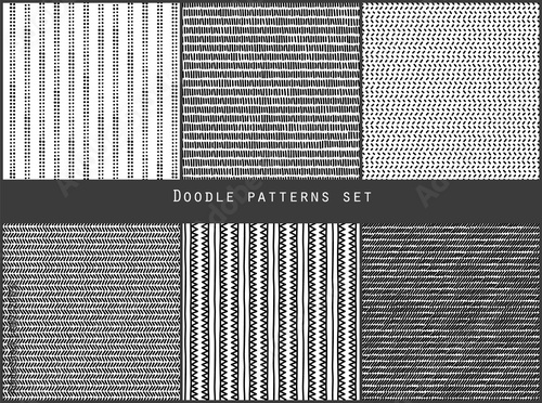 Photo  Simple black and white doodle strokes dots and triangles geometric striped seaml