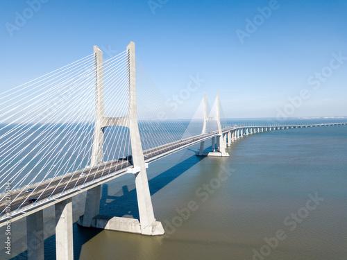 Cuadros en Lienzo Aerial View Of Vasco da Gama Bridge And High Car Traffic In Lisbon City Of Portu