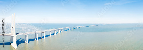 Photo  Aerial View Of Vasco da Gama Bridge And High Car Traffic In Lisbon City Of Portu