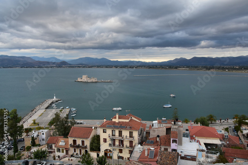 City on the water View from Palamidi castle, Nafplio, Greece to the old town of Nafplio and to Bourtzi water castle in Argolic gulf