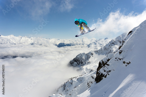 Flying snowboarder on mountains. Extreme winter sport. Tablou Canvas