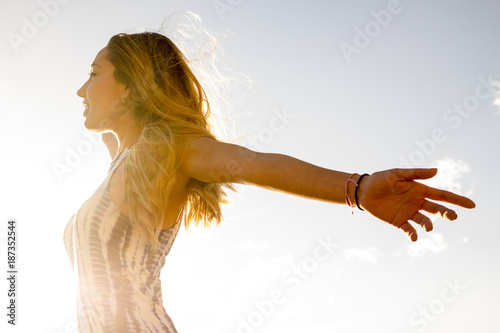 Young beautiful woman open arms for life Wallpaper Mural