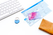Book airplane ticket online. Documents near bank card, wallet and keyboard on white background copyspace