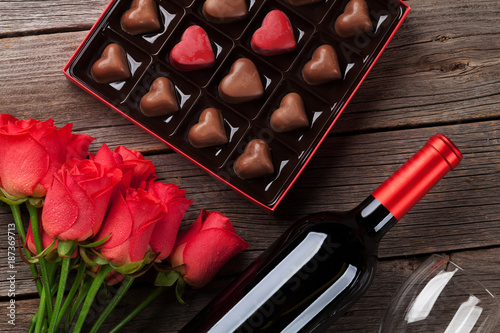 Valentines day with red roses, wine and chocolate