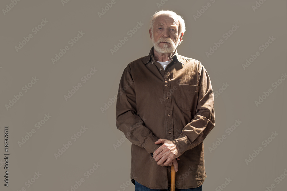 Fotografie, Obraz  Waist up portrait of serious old man looking at camera with tranquility