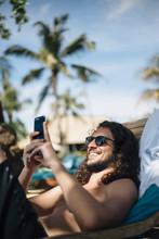 Man Using Phone On The Beach