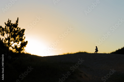 silhouette on the dunes at sunset in Punta del Este, Uruguay Canvas Print